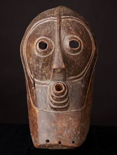 Masks of the Bwandi Bwa Kifwebe Society aid its leaders in the exercise of economic & political power by evoking the help of supernatural forces. Songye masks are distinguished by rows of grooves on th emask face, representing the subterranean region from which the primordial couple emerged. The masks depict either a male or female spirit. Female masks are predominantly white or have retained the color of the wood; male masks usually incorporate the color red. Male masks have an upstanding…