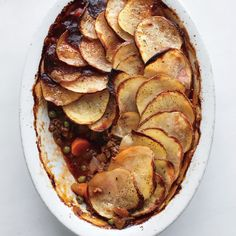 A traditional cottage pie is made with ground beef and topped with mashed potatoes. We used potato slices, which saves time and looks good, too. For a shepherd's pie, use lamb. Or, try a turkey twist: Add 2 cups finely minced turkey meat along with the peas.