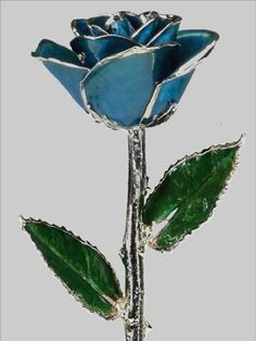 I love the blue rose with silver trim. Start a collection of every color. Prices start at $62.50.