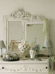 love the 2 different mirrors~but I would take out the little lamps, just the 1 tall apothacary with white, possibly the little frame, but then, I prefer simplicity
