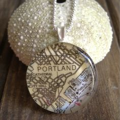 Specify the longitude and latitude of your fave spot and wear it close to your heart on a chain. I chose the location of my wedding. Key West Map, Gifts For Wedding Party, Party Gifts, Heavenly Day, Map Necklace, Belt Buckles, Metal Working, Christmas Bulbs, Boothbay Harbor