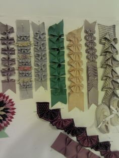 Ribbon origami embellishment /Candace Kling Love the two-tone purple one! ribbon trim ideas - could do these with straight cut fabric hemmed. ribbon trim ideas - /StitchUpHistory/regency-trims-and-furbelows/ START at beginning! ribbon trim ideas, this is Ribbon Art, Fabric Ribbon, Ribbon Crafts, Fabric Flowers, Ribbon Flower, Sewing Hacks, Sewing Tutorials, Sewing Crafts, Sewing Projects