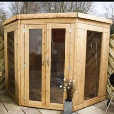 summerhouse 7x7 corner pent tg delivered built and with a base