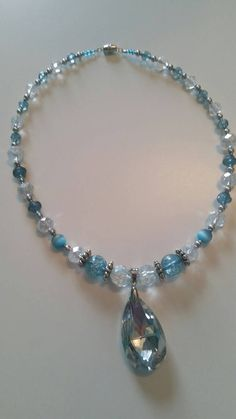 Check out this item in my Etsy shop https://www.etsy.com/listing/268273575/aqua-beaded-necklace-with-tear-drop