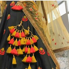 The ultimate list of gorgeous Lehenga and Blouse Latkan designs that are ruling the internet. From tassels to pom-pom designs, choose not just one but more. Indian Attire, Indian Wear, Indian Dresses, Indian Outfits, Pakistani Dresses, Saree Tassels, Lehenga Designs, Indian Designer Wear, Textiles