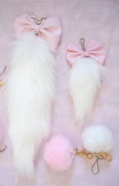 Pink and white tails: fox, bunny, cat- with bows! Eeek, so cute!!! :3