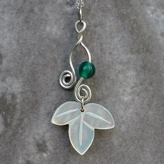 Mother of Pearl Leaf Design Pendant Necklace with Sterling Silver Chain by Antique Alive Jewelry, http://www.amazon.com/dp/B00790QBDY/ref=cm_sw_r_pi_dp_MPB9rb0EXW68Y