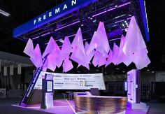 Freeman Booth @ Expo Expo 2011 - Resin cones imbued with a color chosen by attendees started an individualized sensory experience that incorporated sight, sound, and smell into Freeman's marketing message that the company customizes its solutions for clients. Staffers even appealed to attendees' sense of taste, offering them candies that corresponded to the overhead lighting colors.