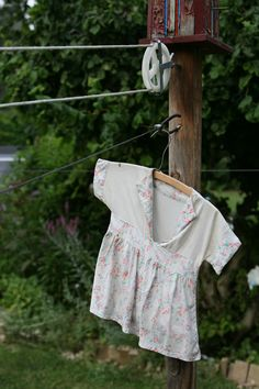 out grown dress made into the clothes pin holder [Google Image Result for http://rutheh.files.wordpress.com/2011/07/clothesline.jpg]