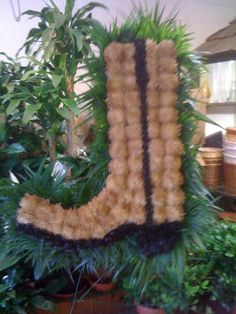 Never seen anything like this. Great way to customize. Funeral Arrangement Cowboy boot.
