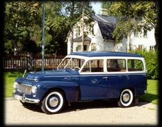 Dark blue and white 1958 Volvo PV445 Duett.