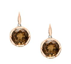 Cinnamon-mocha tones of faceted Smokey quartz entrance and enchant in 18k rose gold floret drop earrings. Cool .925 silver design flourishes captivate from every angle.