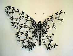 Large butterfly made of a bunch of smaller butterflies