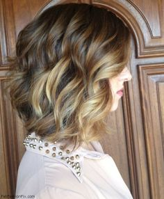 Medium length honey color hair with loose curls