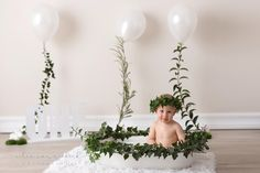Balloons, Greenery Strings, White Bunnies on little patches of moss... This is the cutest milkbath session for a 1 Year old Boy! Greenery & Décor Styling - Pronkertjie Flower & Décor Styling Photographer - Celia van Niekerk Photography