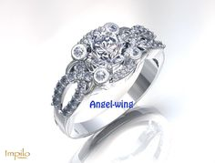 """""""Angel-wing"""" - This stunning criss-cross design has one round brilliant cut diamond centre stone, with four smaller round brilliant cut diamonds on the halo with smaller diamonds around it, surrounded by diamonds on each side of the split shank. An intricate and unique design. First Round, Split Shank, Cross Designs, Criss Cross, Diamond Engagement Rings, Halo, Stone, Centre, Diamonds"""
