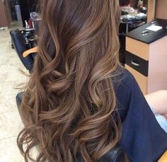 Love these brown curls with a hint of blonde