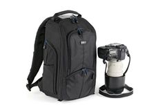 I think it's time to give in to a backpack. $149 Think Tank StreetWalker