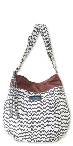 "Kavu Vashon  Cross body bag with adjustable shoulder strap, rope fringe and synthetic leather trim detail, one main compartment with snap closure, internal zip and organizational pockets and key clip.  Dimensions:  14.5"" x 14"" x 2  Fabric:  12oz cotton canvas and denim with synthetic leather trim"