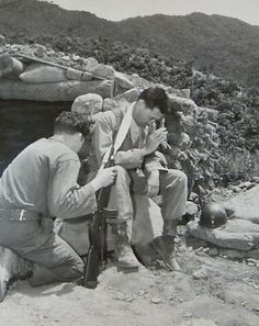 Fr. Harold Prudell hears a soldier's confession on the front lines in Korea, June 23, 1951.
