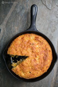 Cornbread packed with cheese, onions, whole corn, and flavored with bacon drippings. Cooked in a cast iron skillet. ~ SimplyRecipes.com