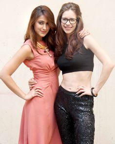 Ileana D'Cruz and Kalki Koechlin pose during a photo shoot to promote 'Happy Ending'.