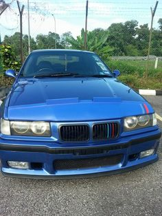 BMW E36 M3 blue with ///M stripe