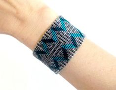 Etsy's Front Page, Beaded Teal Silver Gray and Black Chevron Bracelet, Toho Treasure Seed Bead Bracelet, Geometric Beaded Cuff Bracelet Chevron Armband, Chevron Bracelet, Beaded Cuff Bracelet, Cuff Bracelets, Shades Of Teal, Tear, Loom Beading, Seed Beads, Stitch Patterns