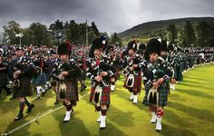 Massed Pipes and Drums during the Braemar Royal Highland Gathering in Scotland. The Queen enjoyed watching the traditional processions