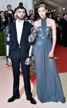 Zayn Malik and Gigi Hadid from Couples and BFFs at the 2016 Met Gala  The singer and model made their official red carpet debut as a couple at the May 2 event, with Zayn rocking robot arms, perfect for the night'sManus x Machina: Fashion in an Age of Technology theme.