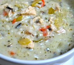 Slow cooker chicken with wild rice soup.Chicken thighs with vegetables and wild rice cooked in slow cooker.