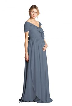 A floor-length convertible maternity bridesmaid gown with flowing layers. Available in Black, Champagne, Dusty Blue, Navy, Claret, Petal Pink, Charcoal, Wisteria and Aubergine. Discover more designer bridesmaid dresses to rent at vowtobechic.com.