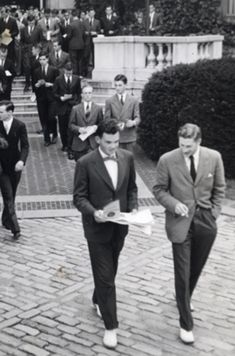 Yale students on the street leaving a university building. 1950s. Student Life at Yale Photographs (RU 736). Manuscripts and Archives, Yale University Library.