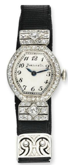 A BELLE ÉPOQUE DIAMOND WRISTWATCH, BY MARCUS & CO. With nickel-finished lever movement, 17 jewels, the white tonneau-shaped dial with black Arabic numerals and blued-steel hands, within a single-cut diamond surround, joined by pierced single and old European-cut diamond tapered links, to the black ribbon band, mounted in platinum, circa 1910, 1¾ ins. diameter. Dial signed Marcus & Co., movement signed Silvana Watch Co.