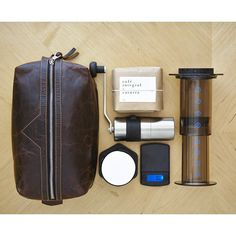 For the coffee dude who has everything, an AeroPress Travel Kit! (I have that grinder too. It's a ceramic one and makes good grounds!)