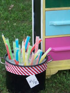 Popsicles in a large pot with ice--I was so excited about this and even had a bucket that matched our theme. Too bad my freezer is dying and the ice pops did not freeze before the party.  It would have been so cute.