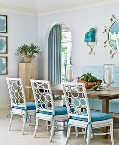 Continue the blue along the kitchen. Partnering it with white walls and chair will instantly brighten up the place. The chairs are wooden in a contemporary design.