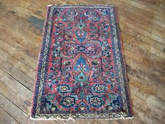 This is Rose. She's a 76 year old vintage Persian rug from Iran. She's 2'x3' which means Rose would be the perfect area rug to greet your guests in the foyer, in the bathroom as a unique bath mat, and