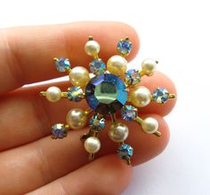 Vintage Golden Starburst Brooch/Pin With Blue Aurora Borealis Stones and Pearls - Vintage Jewelry by FembyDesign