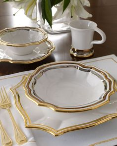 """16-Piece """"Milano"""" Dinnerware Service by OperaNova at Horchow. I ABSOLUTELY LOVE this set with the silver and gold!"""