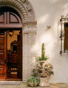A Carved Mexican-Stone Front Door on a New Spanish Colonial House - Mediterranean - Entryway by Ken Tate Architect