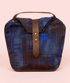 Stylish Lunch Bags- Adult Lunch Boxes | If you've been carrying a brown paper bag or a (shudder) insulated, nylon lunch bag, we've rounded up some seriously stylish lunch boxes that you'll be proud to pack. Here are some lunch bags for adults from Refinery29.com! #refinery29 http://www.refinery29.com/chic-lunch-boxes-that-won-t-make-you-feel-like-a-kid