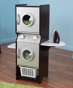 This realistic play set features a stacked washer and dryer with electronic sounds, lights and clicking knobs that make for an engaging play experience. It comes complete with a mini iron, built-in shelves and a laundry basket for more interactive fun. Includes washer and dryer, iron and laundry basketWasher and dryer: 28.75'' W x 37.25'' H x 13.7'' D...