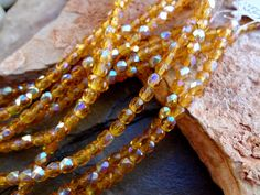 Amber AB, 4mm Czech Firepolish Rounds, 38 Beads per Strand, One Strand per Order by DragonflyBeadsStudio on Etsy