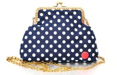 Red button decorates this nice blue white dotted bag and red fabric has been sewn inside. The clutch purse/bag is softly padded with fleece and can store your little wallet, mobile, tissue etc.Special piece for special ladies :)Size: 15 X 20 cm