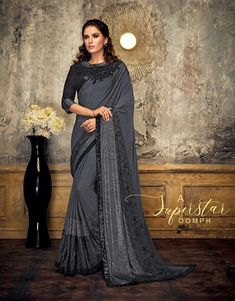 Product Features: Saree Color: Grey Blouse Color: Black Saree Fabric: Lycra Blouse Fabric: Raw Silk Type of Work: Sequins Border Product Weight: 500 Gram Occasion: Partywear Fabric Care: Dry Clean Disclaimer: Color May Vary due to Photographic Effect Raw Silk Saree, Indian Silk Sarees, Ethnic Sarees, Fancy Sarees, Party Wear Sarees, Buy Designer Sarees Online, Grey Saree, Wedding Saree Collection, Indian Clothes Online