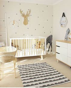 NURSERY / / Lovely gender neutral nursery in white, timber and grey with a Moses basket set up next to the cot all ready for baby. ✔️ @mysweetsanctuary_ via @vividwalldecals