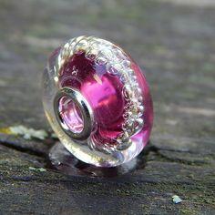 Růžovík+Ag925/1000+Autorská+vinutka+s+s+průvlekem+4,3+mm.+Kovový+lepený+průvlek+Ag+925.+Velikost+15+x+9+mm.+Měřeno+s+kovovým+okrajem.
