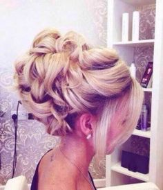 updo hairstyle...I like the bangs, would probably want something more natural for the bun