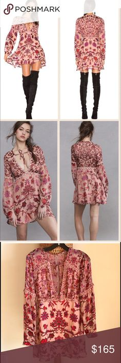 """For love and lemons saffron mini sunset floral M Whimsical fit and flare dress is crafted from the softest silk blend. Gorgeous floral print throughout. Deep v neckline with self ties, and a flirty cutout. Long sleeves with buttoned cuffs. Scalloped piping for a sleek finish. Concealed back zip closure. Straight hem at flared skirt. Lined. 75% viscose, 25% silk; Lining: 97% polyester, 3% spandex. Dry clean only. Imported. Model is 5'6, 34""""chest 27"""" waist. She wears S. For Love and Lemons…"""